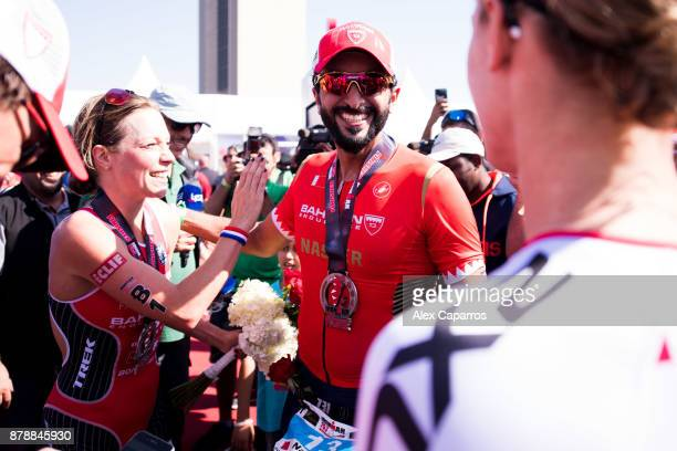 Sheikh Nasser Bin Hamad Al Khalifa is congratulated by Holly Lawrence of Great Britain and Daniela Ryf of Switzerland after finishing the men's race...