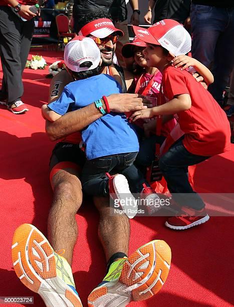 Sheikh Nasser Bin Hamad Al Khalifa of Bahrain reacts with his children after finishing Ironman Bahrain on December 5 2015 in Bahrain Bahrain