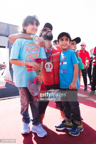 Sheikh Nasser Bin Hamad Al Khalifa reacts with his children after finishing the men's race of IRONMAN 703 Middle East Championship Bahrain on...