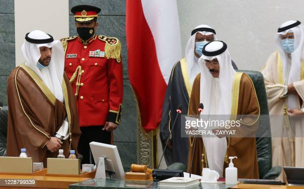 Sheikh Nawaf al-Ahmad Al-Sabah reads a statement asfter being sworn in as Kuwait's new Emir at the National Assembly in Kuwait City, as Parilament...
