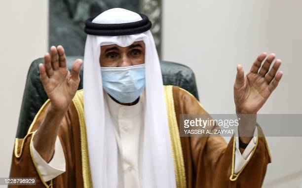 Sheikh Nawaf al-Ahmad Al-Sabah salutes the crowd after being sworn in as Kuwait's new Emir at the National Assembly in Kuwait City on September 30,...