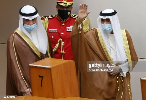 Sheikh Nawaf al-Ahmad Al-Sabah salutes the crowd after being sworn in as Kuwait's new Emir at the National Assembly in Kuwait City, as Parilament...
