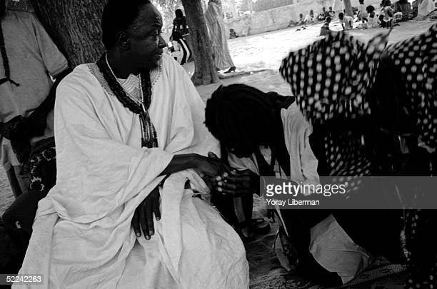 Sheikh Ndigal Fall receives pilgrims in his house garden during the pilgrimage of the Magal De Touba April 23 2003 in Touba Senegal The Mouride Baye...
