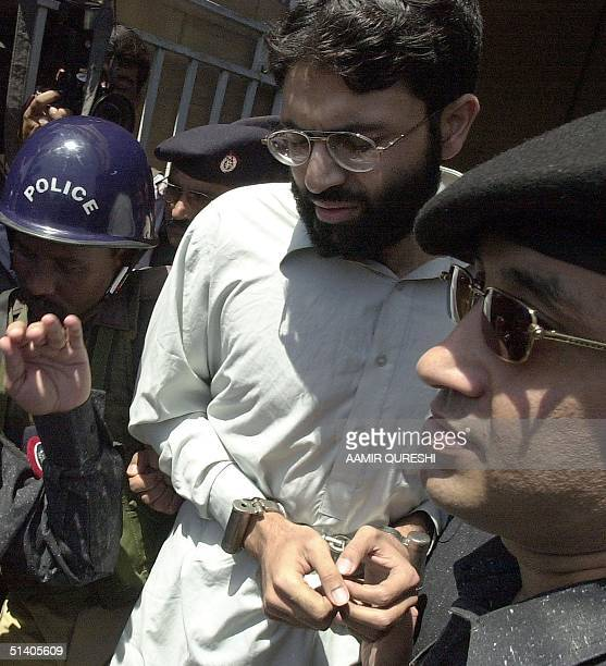 Sheikh Omar, chief suspect in US journalist Daniel Pearl's abduction is surrounded by the Pakistani police in the port city of Karachi, 29 March...