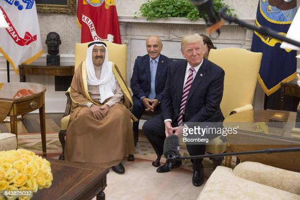 Sheikh Sabah AlAhmed AlSabah Kuwait's emir left and US President Donald Trump right sit during a meeting at the Oval Office of The White House in...