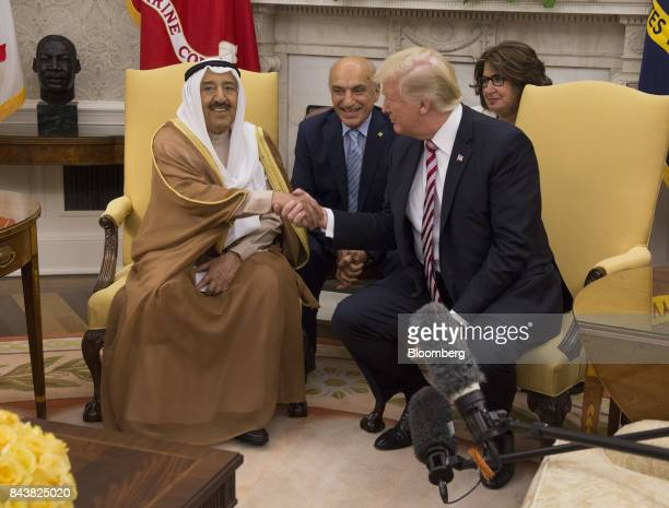 Sheikh Sabah AlAhmed AlSabah Kuwait's emir left shakes hands with US President Donald Trump right during a meeting at the Oval Office of The White...