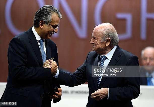 Sheikh Salman Bin Ebrahim Al Khalifa of Bahrain receives a medal from FIFA President Joseph S Blatter after becoming FIFA VicePresident during the...
