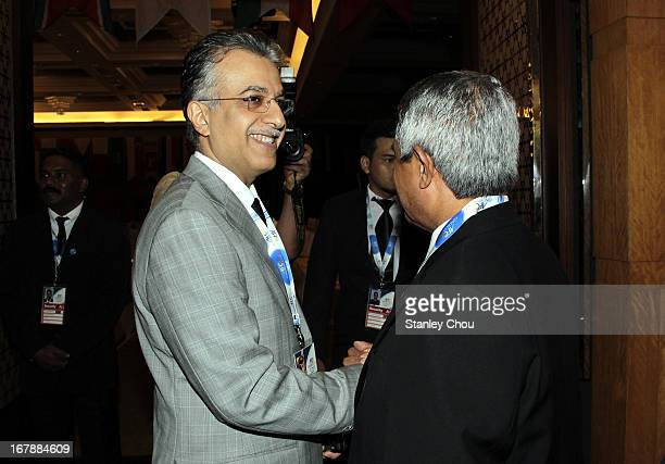 Sheikh Salman Bin Ebrahim Al Khalifa of Bahrain shake hands with a delegate after he was elected as the 11th President of the Asian Football...