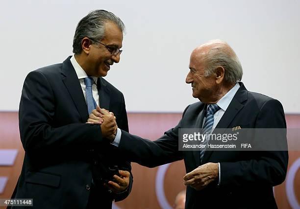 Sheikh Salman Bin Ebrahim Al Khalifa of Bahrain shakes hands with FIFA President Joseph S Blatter after becoming FIFA VicePresident during the 65th...