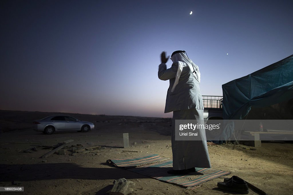 Sheikh Sayah Al Turi prays on October 9, 2013 in the Bedouin village of Al-Arakib, Israel. Roughly 200,000 Bedouins live in the Negev desert, with about half living in the seven Israeli government built townships in the northeast of the Negev and half in unrecognized villages, which lack basic services such as clean water, electricity or sanitation. The Israeli Parliament (Knesset) is set to bring a final vote on the Prawer-Begin Bill during its winter session, which starts this week. If implemented the law would forcibly displace tens of thousands of Arab Bedouin citizens living in the unrecognized villages and see them settled in the seven Bedouin townships. The Negev Bedouin tribes have vowed to fight the proposed law, which they argue will dispossess them of their homes and force a final settlement to their claims of historical rights to the land.