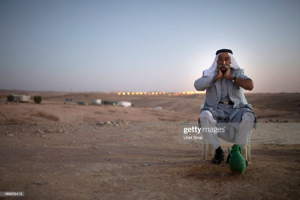 Sheikh Sayah Al Turi washes his face on October 9, 2013 in the Bedouin village of Al-Arakib, Israel. Roughly 200,000 Bedouins live in the Negev desert, with about half living in the seven Israeli government built townships in the northeast of the Negev and half in unrecognized villages, which lack basic services such as clean water, electricity or sanitation. The Israeli Parliament (Knesset) is set to bring a final vote on the Prawer-Begin Bill during its winter session, which starts this week. If implemented the law would forcibly displace tens of thousands of Arab Bedouin citizens living in the unrecognized villages and see them settled in the seven Bedouin townships. The Negev Bedouin tribes have vowed to fight the proposed law, which they argue will dispossess them of their homes and force a final settlement to their claims of historical rights to the land.
