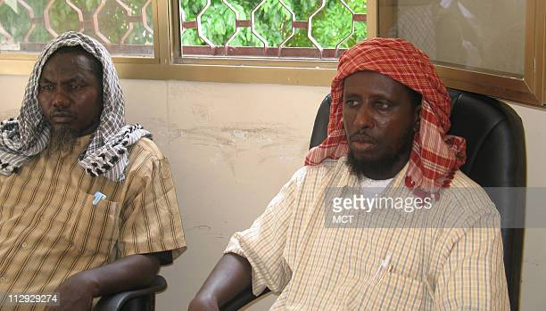 Sheikh Sherif Ahmed right chairman of the Islamic Courts Union relaxes with an adviser at his office in Mogadishu Somalia The Islamic Courts Union...