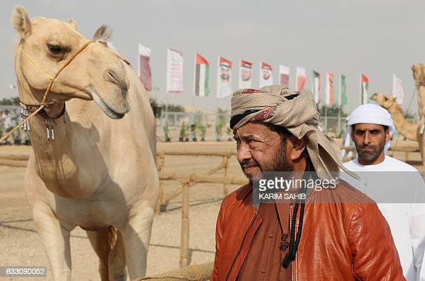 Sheikh Sultan Bin Zayed alNahyan inspects a camel during the camel festival at the Sweihan racecourse in AlAin on the outskirts of Abu Dhabi on...