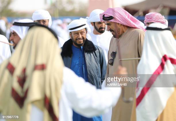 Sheikh Sultan bin Zayed alNahyan the brother of Emirati President Sheikh Khalifa bin Zayed and his representative stands amid unidentified guests and...