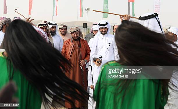 Sheikh Sultan Bin Zayed alNahyan watches Emiratees perform a traditional dance during the camel festival at the Sweihan racecourse in AlAin on the...