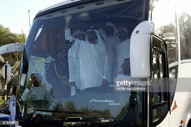 Sheikh Tahnun bin Zayed Sheikh Zayed bin Sultan alNahayan's son waves to the crowd during the funeral of his father in Abu Dhabi 03 November 2004...