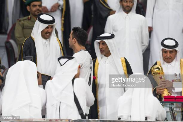 Sheikh Tamim bin Hamad Al Thani Emir of Qatar congratulates Xavi captain of Al Sadd on winning the 2017 Emir Cup at Khalifa International Stadium on...