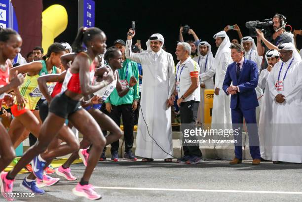 Sheikh Tamim bin Hamad Al Thani signals the start of the Marathon after the Opening Ceremony on day one of 17th IAAF World Athletics Championships...