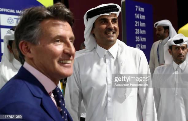 Sheikh Tamim bin Hamad Al Thani , the Amir of the State of Qatar, watches alongside IAAF President, Sebastian Coe , during the start of the Marathon...
