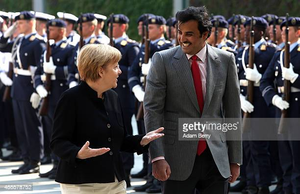 Sheikh Tamim bin Hamad Al Thani the eighth and current Emir of the State of Qatar attends a military welcome ceremony with German Chancellor Angela...