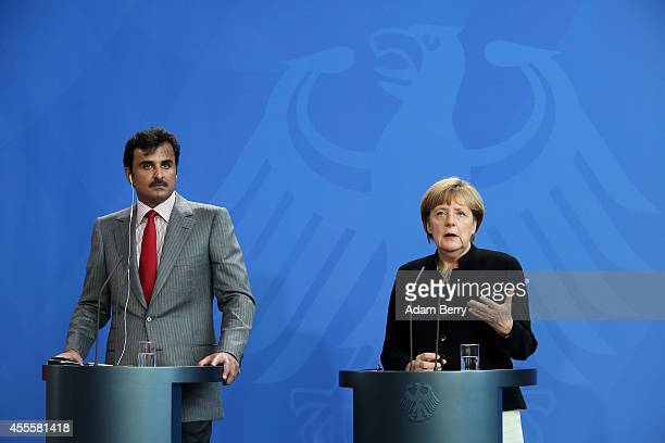 Sheikh Tamim bin Hamad Al Thani the eighth and current Emir of the State of Qatar listens during a press conference with German Chancellor Angela...