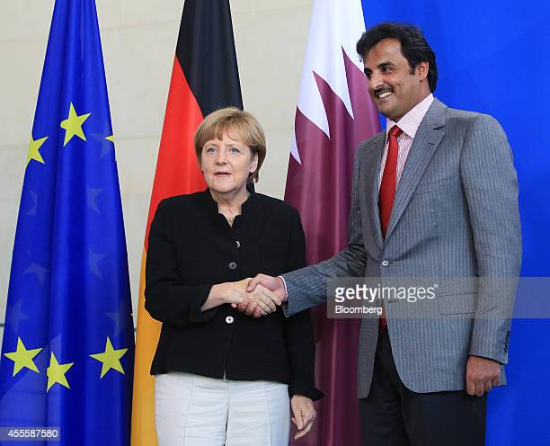 Sheikh Tamim bin Hamad Al Thani the Emir of Qatar right and Angela Merkel Germany's chancellor pose for a photograph following a news conference at...