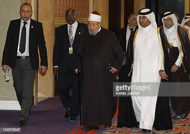 Sheikh Yusuf alQaradawi arrives at the opening of the International Conference on Jerusalem in Doha on February 26 2012 Qatar called for the creation...