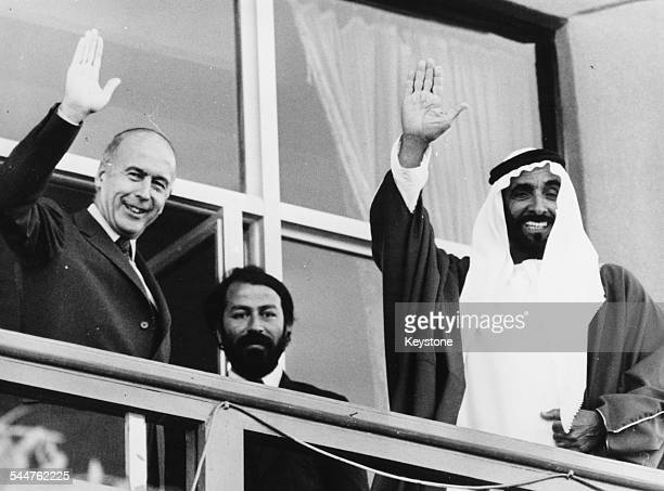 Sheikh Zayed Bin Sultan Al Nahyan And French politician Giscard d'Etaing waving from a balcony in Abu Dhabi March 1st 1980