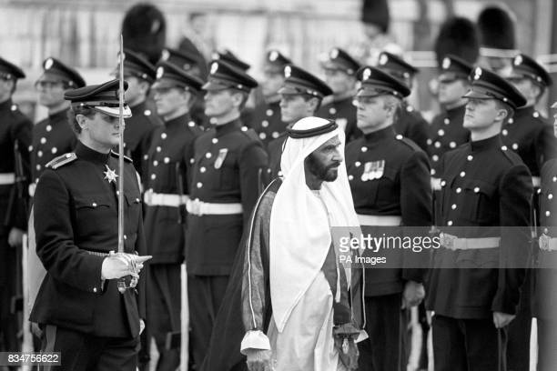 Sheikh Zayed bin Sultan AlNahayan inspects the Honourable Atillery Company's guard of honour when he arrived at Guildhall this evening for a banquet...
