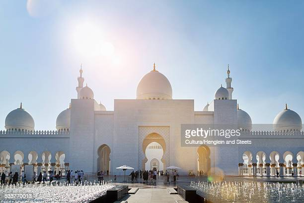 sheikh zayed mosque at daytime, abu dhabi, united arab emirates - mosque stock pictures, royalty-free photos & images