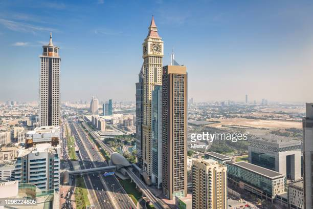 sheikh zayed road dubai skyscapers united arab emirates - mlenny stock pictures, royalty-free photos & images