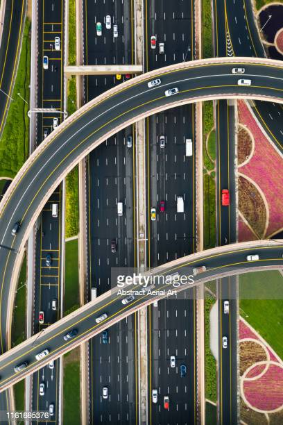 sheikh zayed road from above, united arab emirates - drone point of view stock pictures, royalty-free photos & images