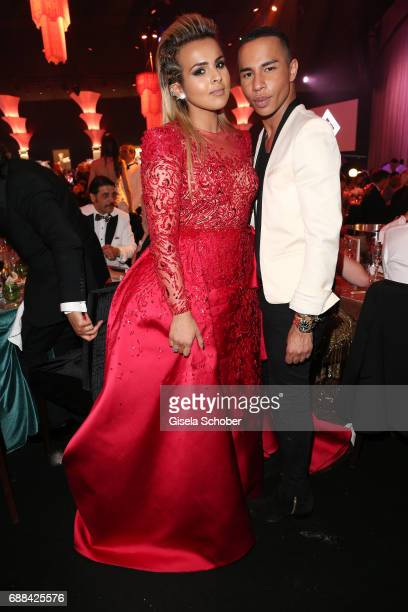 Sheikha Aisha Al Thani and Olivier Rousteing attend the amfAR Gala Cannes 2017 at Hotel du CapEdenRoc on May 25 2017 in Cap d'Antibes France