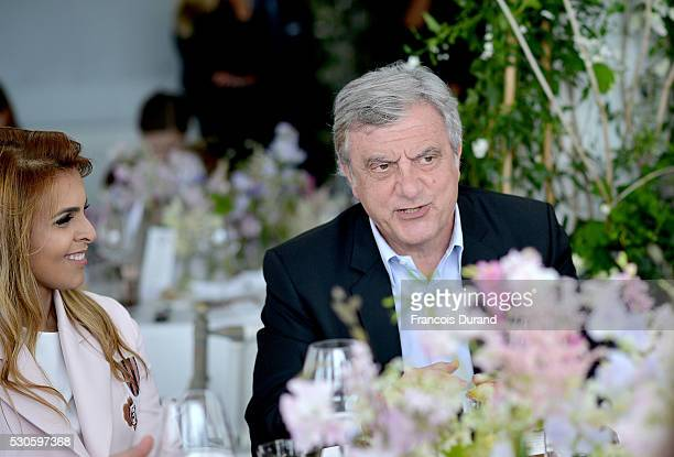 Sheikha Aisha Al Thani and Sidney Toledano attend the Dior Boutique Opening celebration lunch during the 69th Annual Cannes Film Festival on May 11...