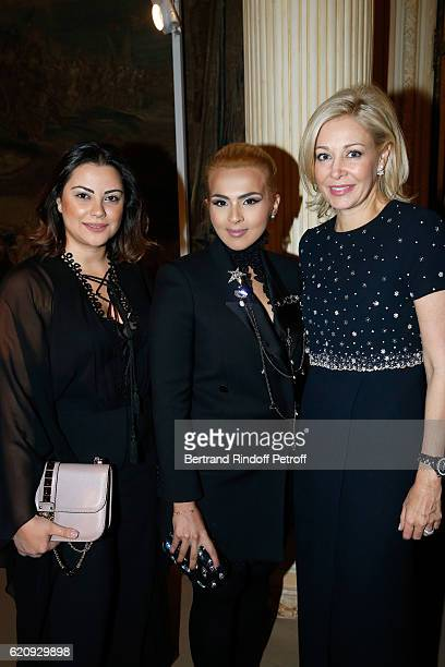 Sheikha Aisha Al Thani Marketing Manager at 'Place Vendome Qatar' Carol Sabbagha and CEO of Swarovski UK Ltd Nadja Swarovski attend the Vogue Fashion...