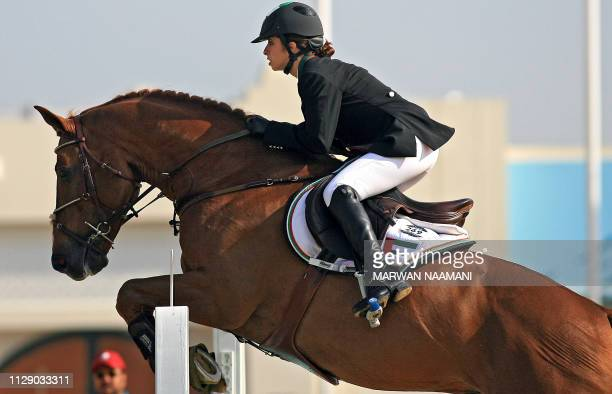 Sheikha Latifa al-Maktoum from the United Arab Emirates clears an obstacle on her horse Kalaska De Semilly during the equestrian jumping individual...