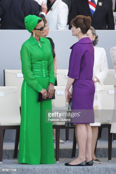Sheikha Moza Bint Nasser alMisnad wife of the Qatari Emir and French first lady Carla BruniSarkozy attend the Bastille Day ceremony on July 14 2008...