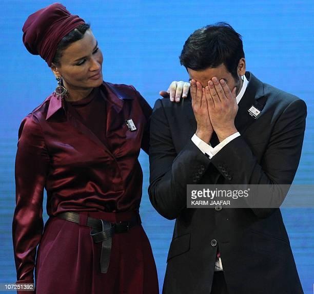 Sheikha Moza wife of Qatar's Emir Sheikh Hamad bin Khalifa alThani looks at her son Sheikh Mohammed bin Hamad alThani chairman of the Qatar 2022 bid...