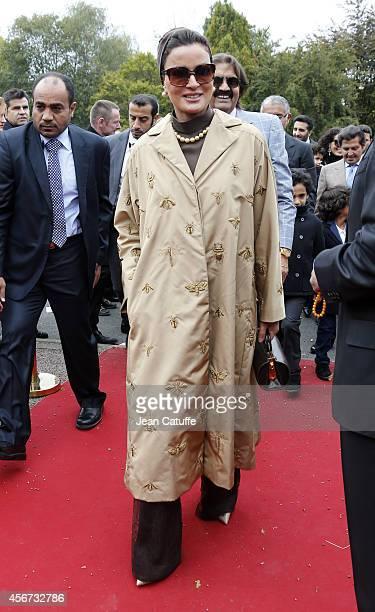 Sheikha Mozah bint Nasser Al Missned attends the Qatar Prix de I'Arc de Triomphe at Longchamp racecourse on October 5, 2014 in Paris, France.