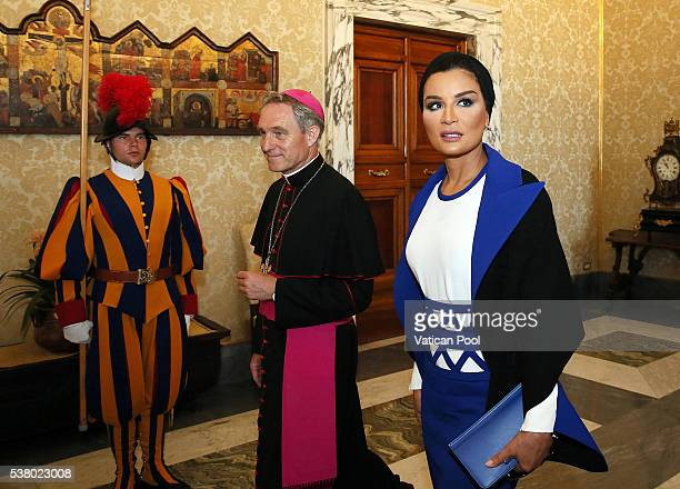 Sheikha Mozah bint Nasser Al Missned flanked by Prefect of the Pontifical House Georg Ganswein arrives at the Apostolic Palace for a meeting with...