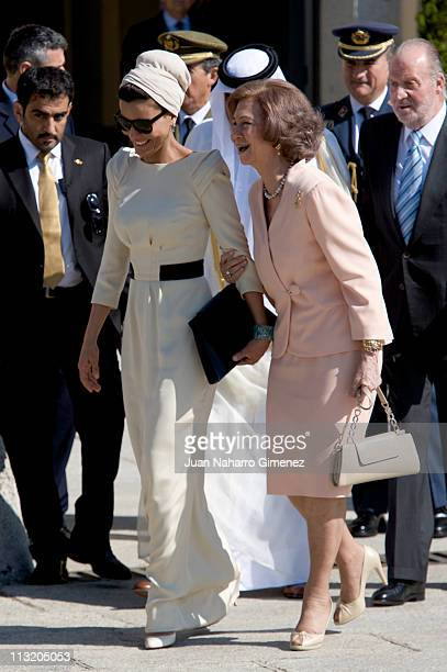 Sheikha Mozah Bint Nasser AlMissned laughs with Queen Sofia of Spain as she loses her shoe during the farewell to the King of Spain at El Pardo...