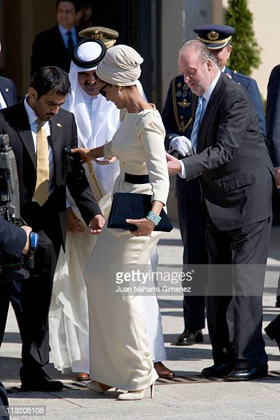 Sheikha Mozah Bint Nasser AlMissned loses her shoe during the farewell to the King of Spain at El Pardo Palace on April 27 2011 in Madrid Spain