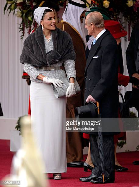 Sheikha Mozah bint Nasser AlMissned talks with Prince Philip The Duke of Edinburgh at the ceremonial welcome for The Emir of the State of Qatar...