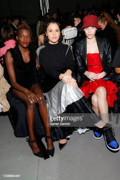 Sheila Atim Jessie Ware and Maxim Magnus attend the Christopher Kane show during London Fashion Week February 2020 on February 17 2020 in London...