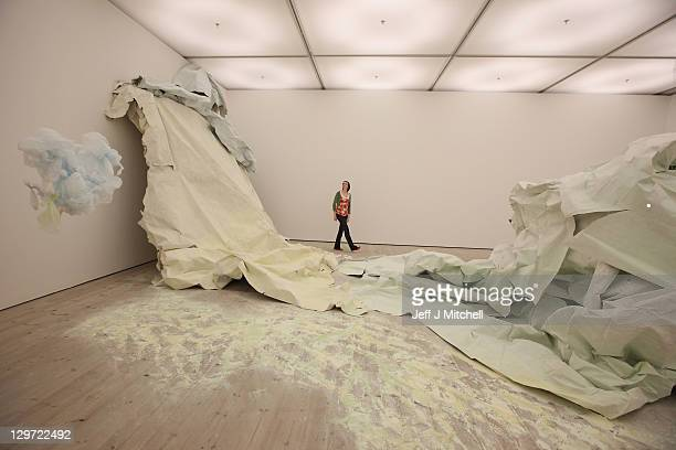Sheila Brownlee stands next to 'More of the Day' by artist Karla Black at the Turner Prize 2011 exhibition at Baltic Centre for Contemporary Art on...