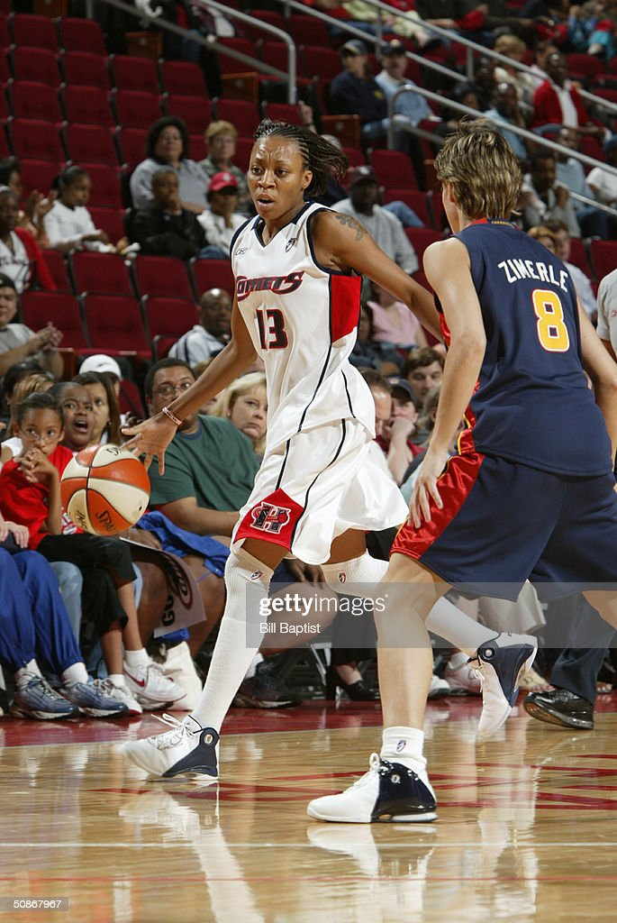 Sheila Lambert #13 of the Houston Comets dribble drives against Anna Zimmerle #8 of the Connecticut Sun during the preseason game at Toyota Center on May 11, 2004 in Houston, Texas. The Comets won 84-71.
