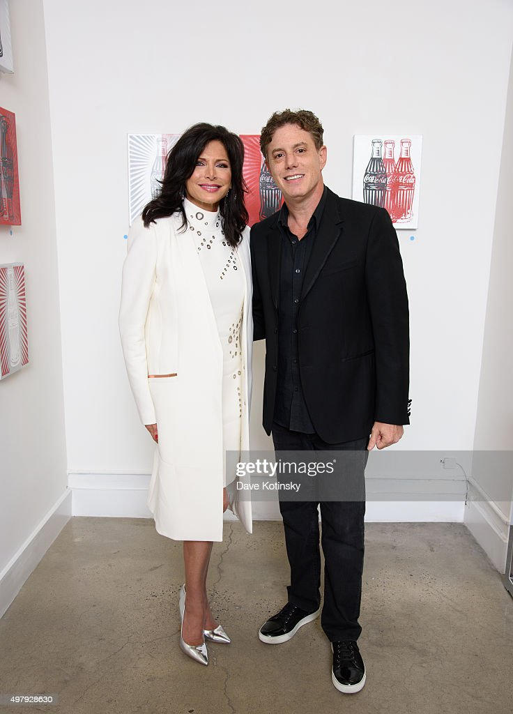 Sheila Rosenblum and Pop Artist Burton Morris attend the Sheila Rosenblum Resident Magazine Cover Party at Soho Contemporary Art Gallery on November 19, 2015 in New York City.