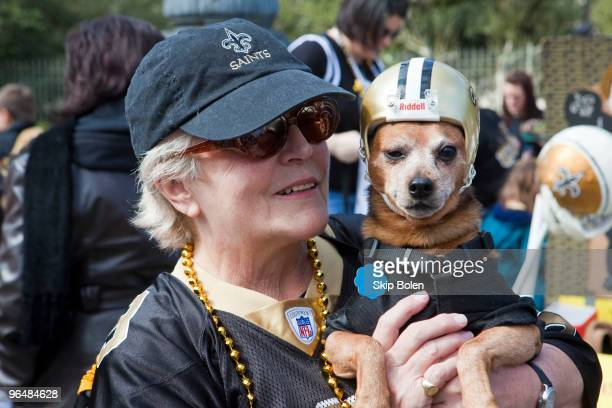 Sheila Tilford and 13 year old Chase dressed in a Saints Football helmet in celebration of the New Orleans Saints being in the SuperBowl today...