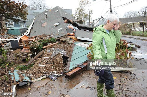 Sheila Traina talks on the phone next to her 40yearold home that was destroyed by the storm surge after Hurricane Sandy flooded the Cedar Grove...