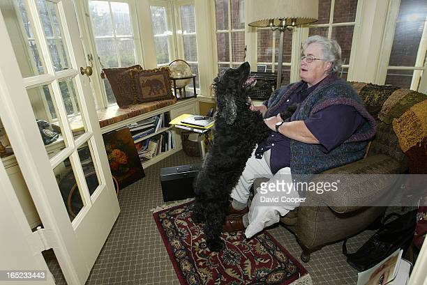 Sheila Ward, new chair of the Toronto District School Board, and her partner Janice Barr with their dog Albert at home. December 6 2003